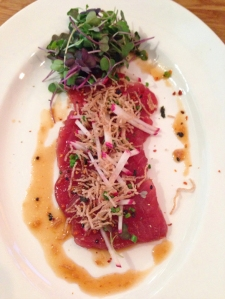Tuna Crudo: thinly sliced tuna, crispy brown rice noodles, radish matchsticks, sprouts, spicy peppers, black sesame seeds, baby green onions
