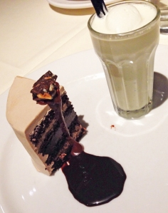 Cake and shake: chocolate layer cake, chocolate fudge sauce, and vanilla malted shake