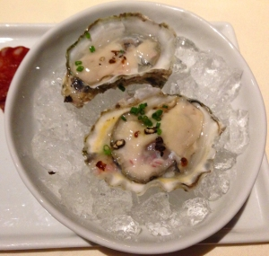 Point Reyes Oysters, served with salumi picante (upper left)