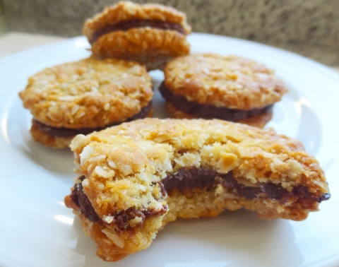 Orange-Scented Anzac Biscuits with Dark-Chocolate Truffle Filling