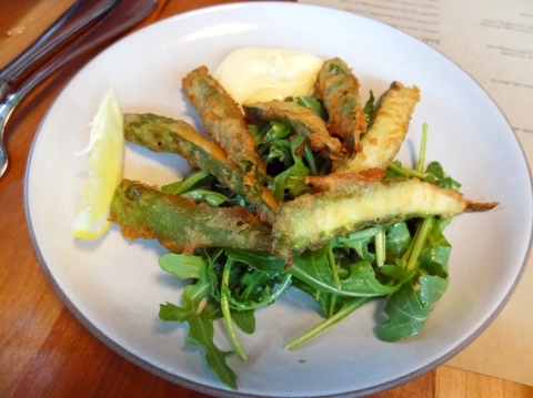 Asparagus tempura with dipping sauce and arugula salad