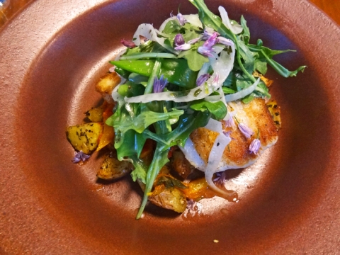 Pan-seared halibut with greens, potatoes, seasonal flowers