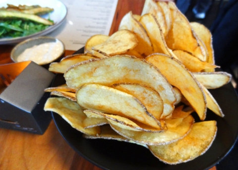 Thick-cut housemade potato chips with onion dip