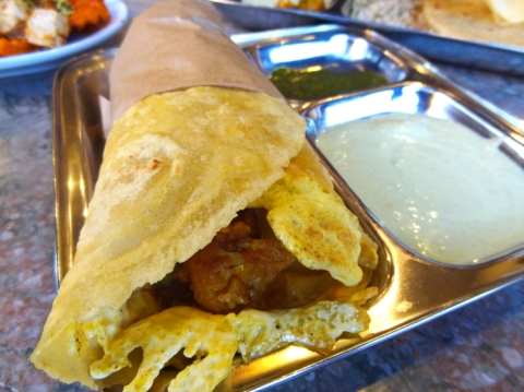 Gluten-Free Kathi Roll: Egg washed pan-fried gluten-free flat bread, pickled onions & chutneys rolled up with aloo gobi