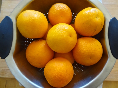 Navel oranges in a stainless steel colander