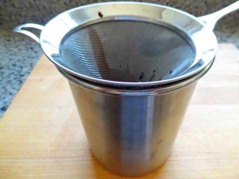 Straining the chocolate sherbet mixture