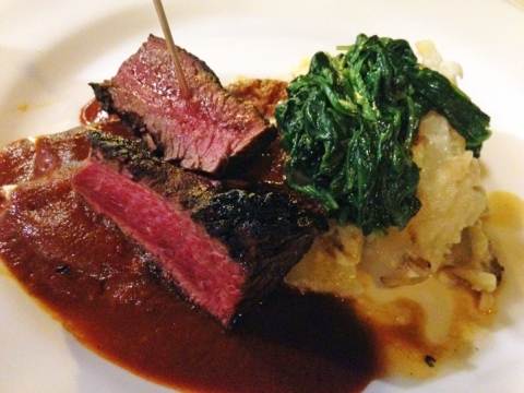 Carne a la Tampiquena: hanger steak, red sauce cheese enchilada, confit potatoes, garlic spinach
