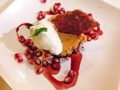 Pastel de Calabaza: pumpkin cheesecake, walnut crust, pomegranate sauce, citrus cream