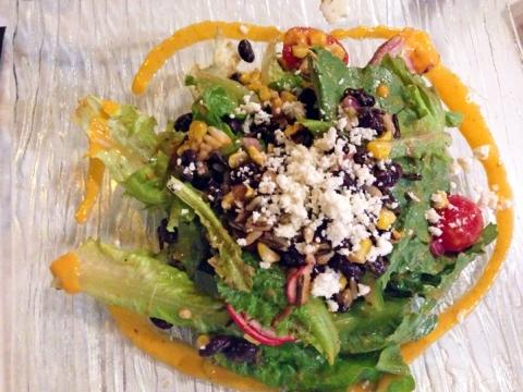 Ensalada de Morisqueta: mixed greens, wild rice, corn, beans, cactus, serrano chile, and tomato dressing