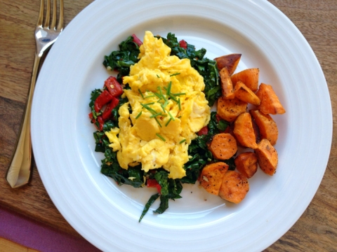 Weekend brunch indulgence, inspired by this month's CSA deliveries: freshly scrambled eggs over savory kale sauté, served with roasted sweet potatoes