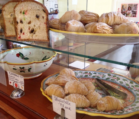 In the case: classic panettone, sfogliatelle, and cannoli