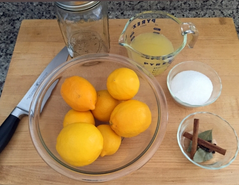 Ingredients for 30-day preserved lemons: Meyer lemons, Meyer lemon juice, salt, cinnamon sticks, coriander seeds, black peppercorns, and bay leaf