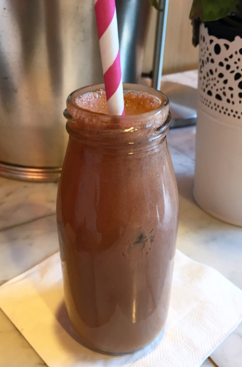 Cold sipping chocolate at Timothy Adams served in a cute bottle with colorful straw