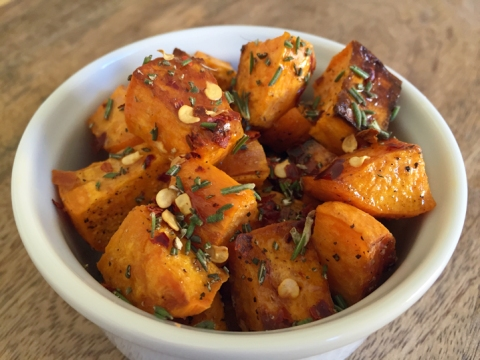 Spicy, salty, herbal, sweet: roasted sweet potatoes with a drizzle of local honey, crushed red pepper, ground sea salt, and fresh rosemary.