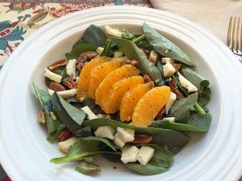 Fava Leaf and Spinach Salad with Orange, Smoked Mozzarella, and Toasted Pecans