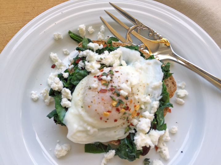 Put an egg on it: Poached Egg and Sautéed Fava Greens on Toast with Feta