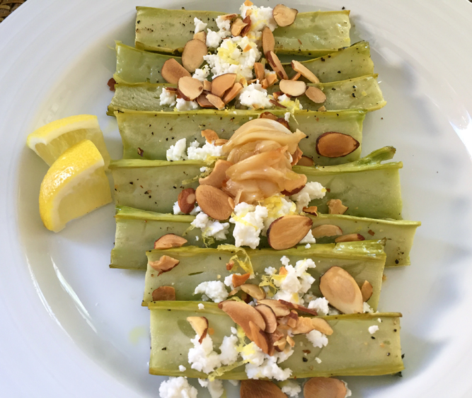 Oven-roasted Broccoli Stems: topped with roasted garlic, lemon zest, toasted almonds, feta cheese