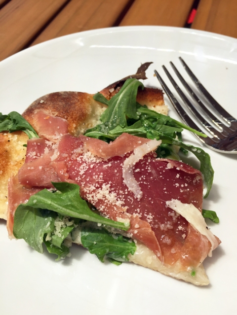 It's a complete meal: Arugula and proscuitto with fresh mozzarella and a hint of creamy garlic sauce on the base