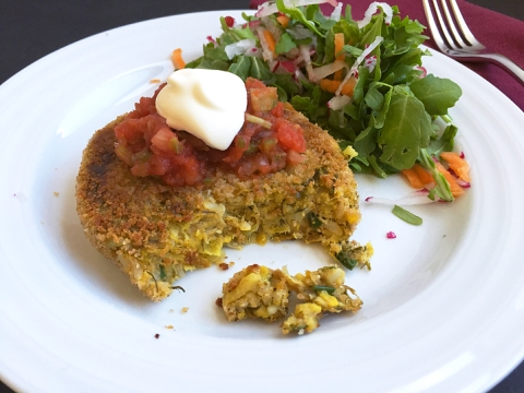 Vegetable burger patty topped with tomato salsa and cultured sour cream
