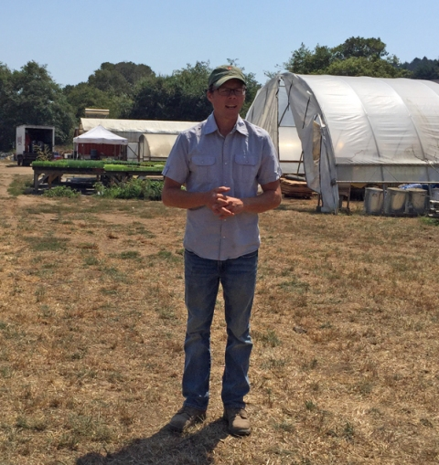 John Vars, one of Fifth Crow Farm's three partner-farmers, getting ready to lead a farm tour